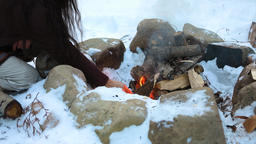 Native warrior man lights campfire Live Action