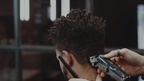 Hair Care. Men's haircut in a barbershop Live Action