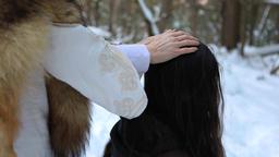 Native shaman healer in winter woodland Live Action