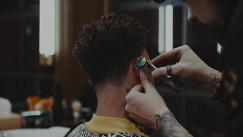 Young Handsome Barber Making Haircut Of Attractive Bearded Man In Barbershop Live Action