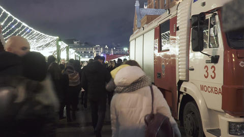 Ambulance and people walking during New Years celebration Live Action