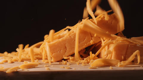 Shredded cheddar cheese falling in slow motion ライブ動画