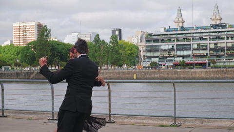 Couple of dance partners recreating a tango routine in Puerto Madero docks Live Action