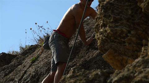 Man Hiking And Climbing Rocks Footage