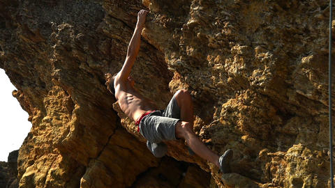 Climber Climbs Up A Rock Footage