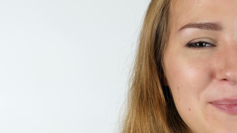 Portrait Of Smiling Half Female Face , White Background Live Action