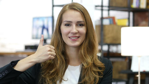 Thumbs Up by Young Girl at Work, Sitting Satisfied in Office Footage