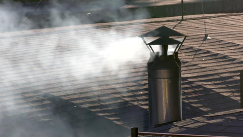 4K Smoke Comes Out of Metal Pipe on Tiled Roof in Front of Quay With Footage