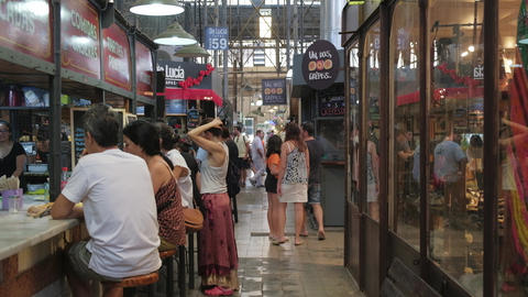 Tourists having lunch in San Telmo Fair food stalls, a touristic destination Live Action