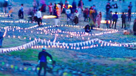 A dusk timelapse of burning romantic candles medium shot tiltshift tilting Live Action