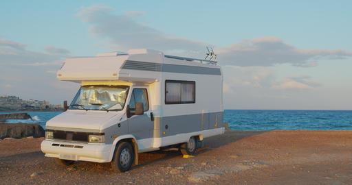 Aerial view. Scenic Sea. Modern Motorhome Rv on the Sea Coast. Concept Vacation Live Action