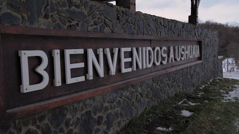 Close up view of Spanish Welcome Sign to Ushuaia, Argentina Live Action