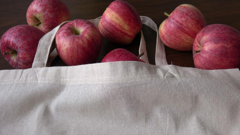 Apples and cotton bag. Eco friendly packaging, zero waste. No plastic concept Live Action