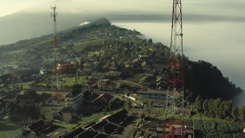 Aerial view of Communication towers build on high altitude agriculture plantation village near Mt Live Action