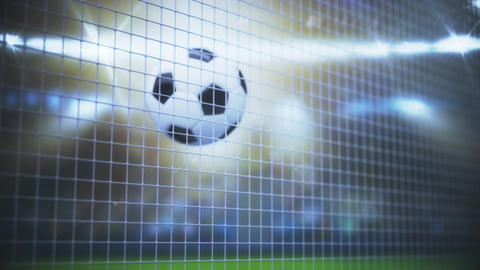 Sport Concept. Soccer Ball flying in Goal Net and spinning in the Net in Slow Live Action