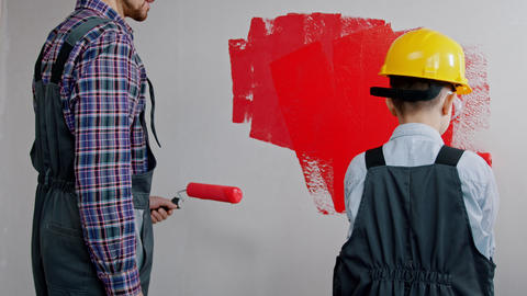 Apartment renovation - family painting walls in red color Live Action