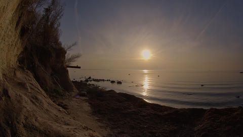 Sunset Over Calm Sea and Sandy Beach Live Action