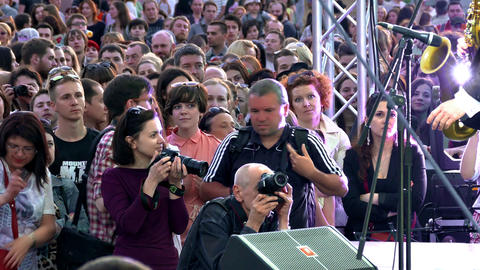 Photographers Take Pictures of Stage During Performance in Open Air Footage