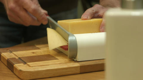 Man cuts cheese Footage