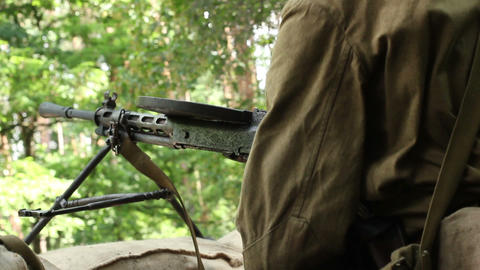 Vintage machine gun spits out series of bullet. World war 2 reconstruction Footage