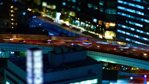 A night timelapse of highway at the urban city in Tokyo tiltshift Live Action