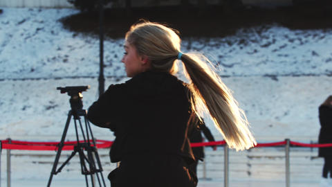 A young woman professional figure skater spinning around herself on ice rink Live Action
