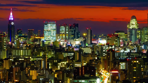 A dusk timelapse of cityscape in Tokyo high angle long shot panning Live Action