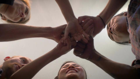 A group of 5 young millennials do an exploding fist bump with their hands togeth Footage