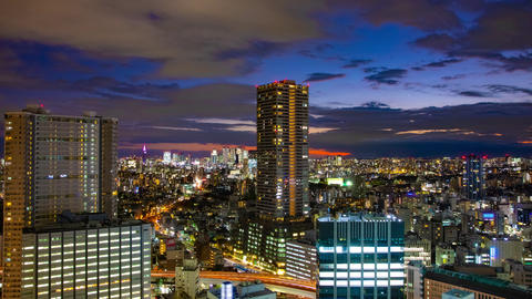 A dusk timelapse of cityscape in Tokyo high angle wide shot tilt Live Action