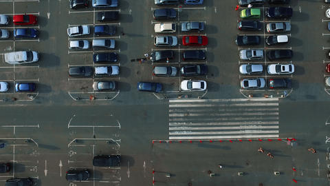 Drone footage people walking at parking. Copter filming parking lot with people Live Action