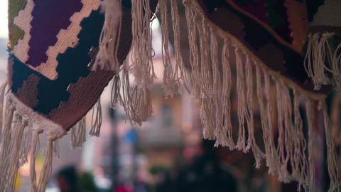 Close-up of a white fringed antique rug in an oriental style on a market in the Live Action