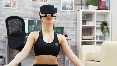 Caucasian woman doing yoga relaxation with virtual reality glasses Live Action