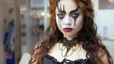 Easy Halloween Makeup. Applying makeup to the face. Drawing red blood on the Live Action