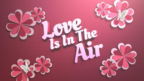 Animated closeup Love is in the Air text and motion romantic heart on Valentine day shiny background Animation
