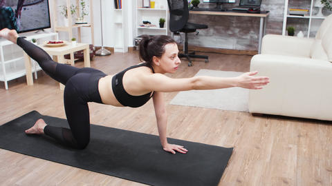 Young woman doing a home workout for a good posture GIF
