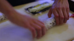 Sushi chef prepares rolls HD close up bokeh video. Japanese cuisine restaurant Footage