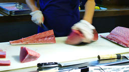 Chef cook cutting knife big bluefin tuna fish 4k close up video sushi restaurant Footage