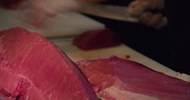 Chefs hands cutting with knife big bluefin tuna fish 4k video in sushi restauran Footage