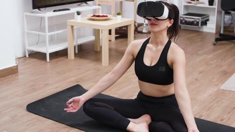Barefoot caucasian young woman with vr headset GIF
