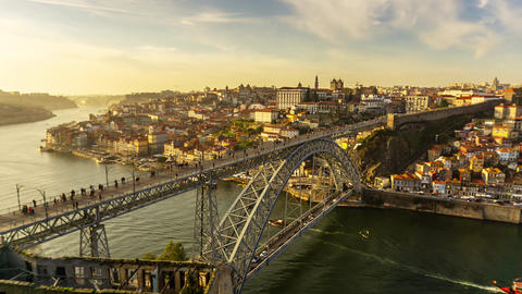 Dom Luis Bridge and Douro river in Porto at sunset Live Action