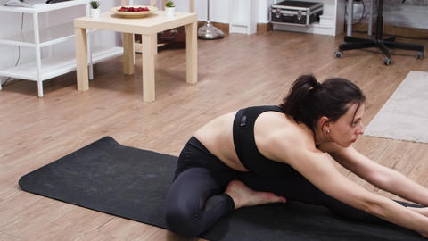 Pretty caucasian adult woman doing yoga GIF