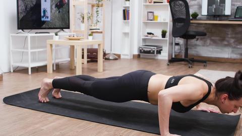 Young woman getting in better shape doing push-ups GIF