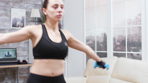 Young woman doing lunges forward in living room Live Action