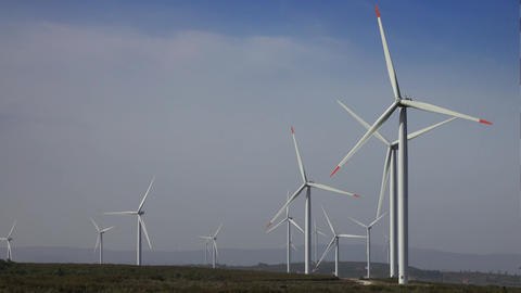 Windmills or wind turbine on wind farm in rotation Live Action