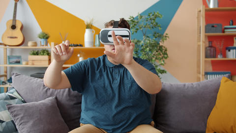 Good-looking man having fun with virtual reality glasses... Stock Video Footage