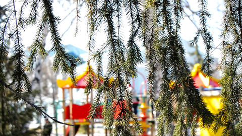 Unfocused multi-colored public Playground on a Sunny spring or summer day. Focus Live Action