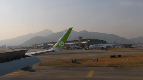 View from taxiing aircraft in Chek Lap Kok airport GIF