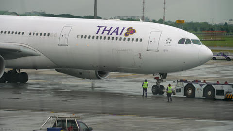 Airliner pushing back before departure GIF