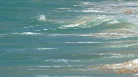 Turquoise rolling wave, slow motion GIF