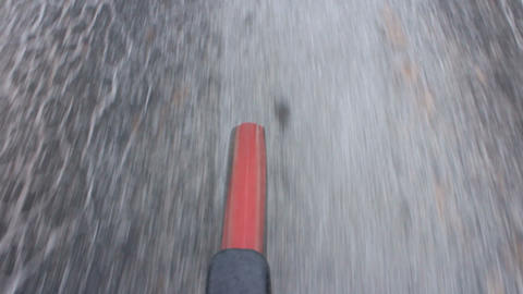 bicycle riding a road in winter Live Action